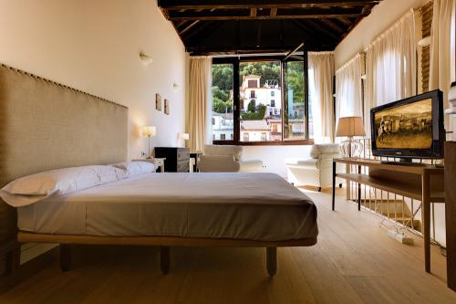 Hotel Syne Alabayzin Hotel de diseño en Granada de 3 estrellas consturido en un antiguo palacio del siglo XVI.